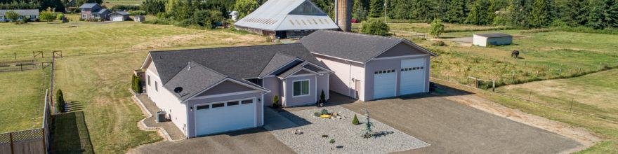 Huge mountain views from this 2017 year built home w/2 gar garage PLUS a 1500 SF RV garage – $514,000